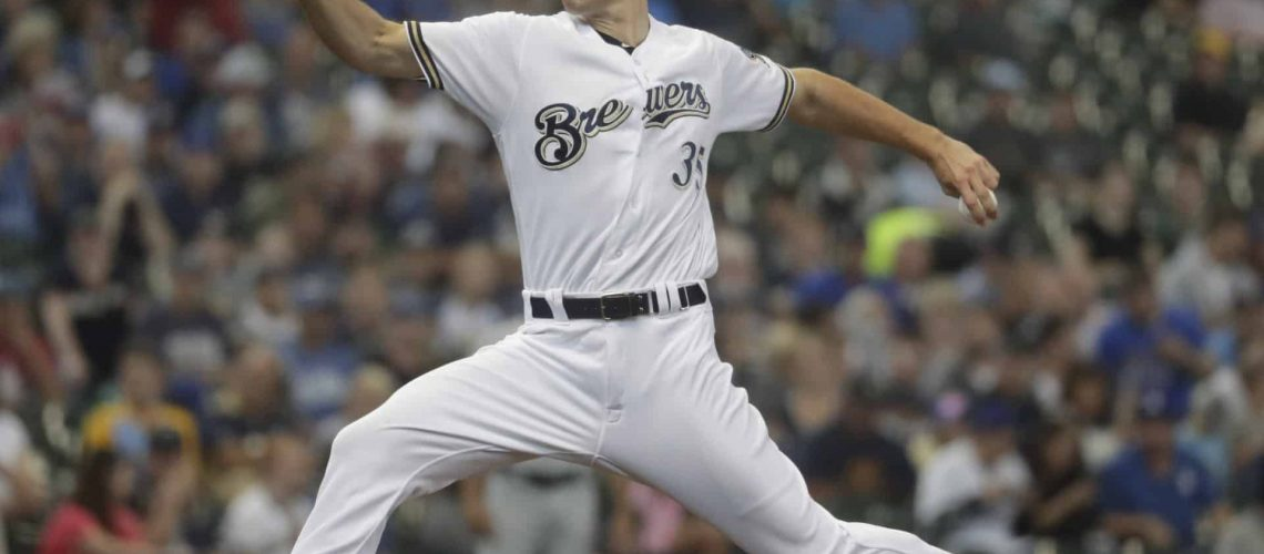 Milwaukee Brewers starting pitcher Brent Suter throws during the first inning of a baseball game against the Los Angeles Dodgers Sunday, July 22, 2018, in Milwaukee. (AP Photo/Morry Gash)